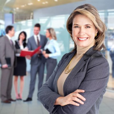 Smiling businesswoman and group of Business people team.